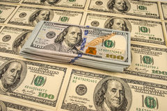 Hintergrund mit Geldamerikaner hundert Dollarscheine Stockbilder