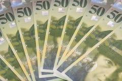 Hintergrund mit 50 Rechnungen des Schweizer Franken Lizenzfreies Stockbild