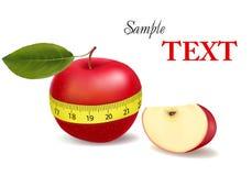 Hintergrund mit rotem Apfel maß das Messinstrument. Stockbilder