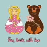 Hintergrund mit russischer Puppe und Bären Lizenzfreie Stockbilder
