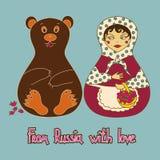 Hintergrund mit russischer Puppe und Bären Lizenzfreie Stockfotos