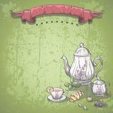 Hintergrund mit Teeservice mit Teeblättern, Hörnchen und Praline Stockfoto