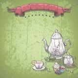 Hintergrund mit Teeservice mit Teeblättern und Frucht backt zusammen Stockbild