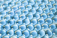 Hintergrund mit vielen blauen Glaskugeln Lizenzfreies Stockbild
