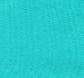 Hintergrund - Nahaufnahme des hellgrünen gesponnenen Baumwollgewebees Lizenzfreie Stockbilder