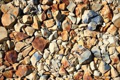 Hintergrund vieler gelben, Schwarzweiss-Steine Stockfotografie