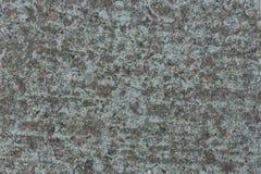 Hintergrund vom Beton mit Imprägnierungen vom roten Granitkies Stockfotografie