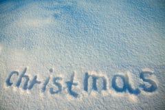 Hintergrund von Aufschrift Weihnachten auf Schnee Stockfotografie