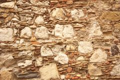Hintergrund von braunen, beige und grauen Steinen Die alte Wand von ston Lizenzfreie Stockfotos