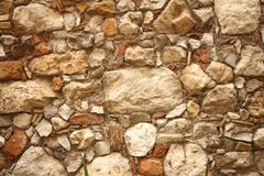 Hintergrund von braunen, beige und grauen Steinen Die alte Wand von ston Stockfoto