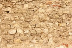 Hintergrund von braunen, beige und grauen Steinen Die alte Wand von ston Stockbild