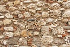 Hintergrund von braunen, beige und grauen Steinen Die alte Wand von ston Lizenzfreie Stockfotografie
