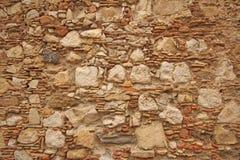 Hintergrund von braunen, beige und grauen Steinen Die alte Wand von ston Lizenzfreie Stockbilder
