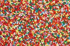 Hintergrund von bunten rund-förmigen Süßigkeiten lizenzfreies stockfoto