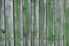 Hintergrund von den Brettern eines grünen Zauns Lizenzfreie Stockfotografie