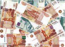 Hintergrund von den fünf-tausendsten und tausend Rubelanmerkungen Stockfotografie