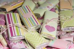 Hintergrund von den Farbschokoladen stockbilder