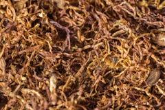 Hintergrund von der natürlichen Zigarettentabak-Braunfarbe Nikotinsucht Stockfotografie