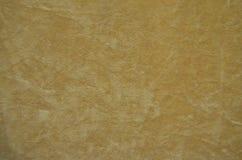Hintergrund von einem beige perfekten Veloursledergewebe Lizenzfreies Stockbild