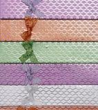 Hintergrund von farbigen Geschenkboxen mit Bögen Lizenzfreies Stockfoto