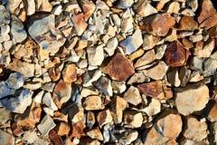 Hintergrund von gelben, Schwarzweiss-Steinen Stockfotografie