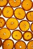 Hintergrund von geschnittenen Orangen Lizenzfreies Stockfoto