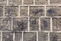 Hintergrund von grauen konkreten Ziegelsteinen Lizenzfreies Stockfoto