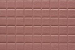 Hintergrund von Quadraten mit einer weichen Beschaffenheit der staubigen rosafarbenen Farbe stockfotografie