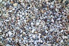 Hintergrund von runden kleinen Steinen Stockfotografie