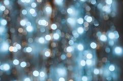 Hintergrund von stark unscharfen Lichtern von Girlanden Stockfoto