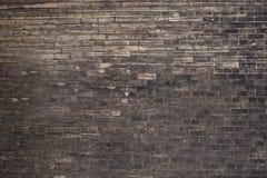 Hintergrundabstraktionsbacksteinmauer mit den schwarzen und grauen Ziegelsteinen stockbild