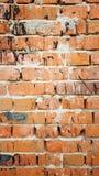 Hintergrundbacksteinmauer mit schwarzen Flecken Lizenzfreies Stockfoto