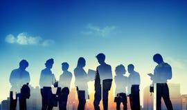 Hintergrundbeleuchtete Geschäftsleute Diskussions-Kommunikations-Konzept- Lizenzfreies Stockbild