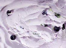 Hintergrundbeschaffenheit der sahnigen Blaubeereiscreme Stockfoto