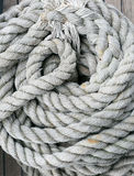 Hintergrundbeschaffenheit des aufgerollten Seils stockbild