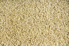 Hintergrundbeschaffenheit des gebrochenen oder zerquetschten Weizens Stockfoto