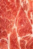 Hintergrundbeschaffenheit des ungekochten fetthaltigen Fleisches für Gebrauch als kochenden Bestandteil stockbild