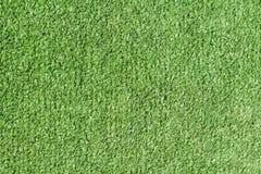 Hintergrundbeschaffenheit mit gefälschtem Gras Stockbilder