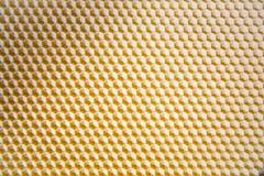 Hintergrundbeschaffenheit und Muster eines Abschnitts der Wachsbienenwabe Lizenzfreies Stockbild