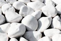 Hintergrundbeschaffenheit von glatten weißen Steinen Stockfotografie