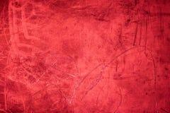 Hintergrundbeschaffenheit/-weinlese des Schmutzes maserten rote Wand in der Dunkelheit Stockbilder