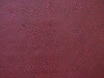 Hintergrundbeschaffenheitsmuster auf der ledernen Burgunder-Farbe Lizenzfreie Stockfotografie