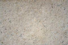 Hintergrundnahaufnahme der Papierbeschaffenheit organische Papp Schmutzalte Papieroberfläche mit Zellulose, Fragmente, Stoppel, H lizenzfreie stockfotografie
