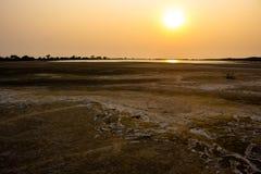 Hintergrundunfruchtbarer Grundsonnenuntergang Lizenzfreie Stockfotos