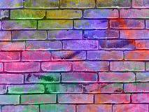 Hintergrundziegelsteinwand Rosa, Blau und andere vibrierende Farben Lizenzfreies Stockfoto