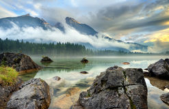 Hintersee. Lake with clear water and large rocks in the water Stock Images