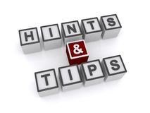 Hints and tips. Text 'hints and tips' inscribed in black uppercase letters on white cubes, white background Stock Photography