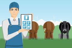 Asian farmer with digital tablet on a pasture. royalty free stock photography