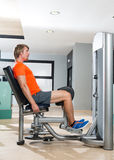 Hip abduction blond man exercise at gym closing. Hip abduction blond man exercise at gym indoor closing legs workout Royalty Free Stock Image