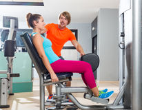 Hip abduction woman exercise at gym closing. Hip abduction women exercise at gym indoor closing legs and personal trainer blond man Stock Photo